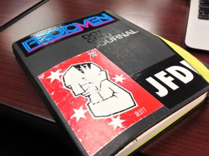 Aaron's notebook with a Protomen sticker is ironic as he didn't put them on his best-of list.